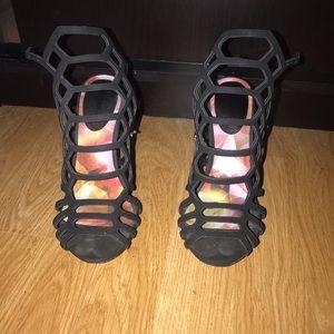 Black cage style. Peep toe heel.